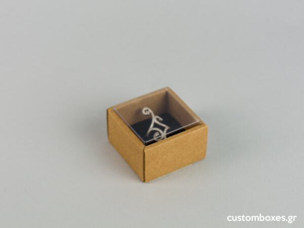 Eco-friendly jewellery box with black velvet insert and transparent lids for rings.