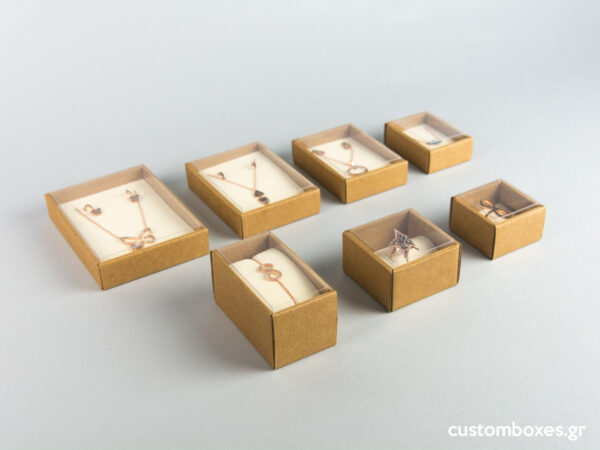 Eco-friendly jewellery boxes with ivory velvet inserts and transparent lids available in 7 sizes.