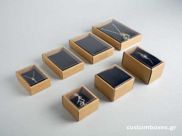 Eco-friendly jewellery boxes with black velvet inserts and transparent lids available in 7 sizes.