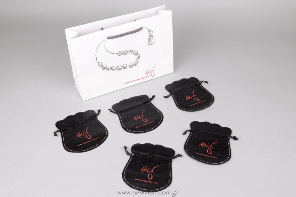 Τυπωμένη χάρτινη τσάντα και δερμάτινα πουγκιά με λογότυπο Mala