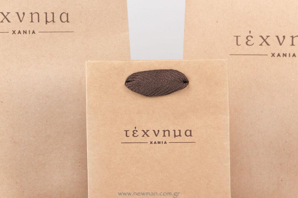 Τέχνημα κοσμηματοπωλείο λογότυπο σε τσάντα