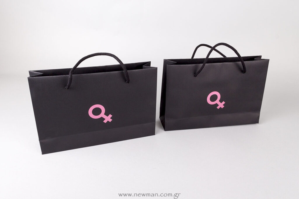 Female Symbol printed on paper bags