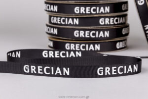 The Grecian logo on ribbon