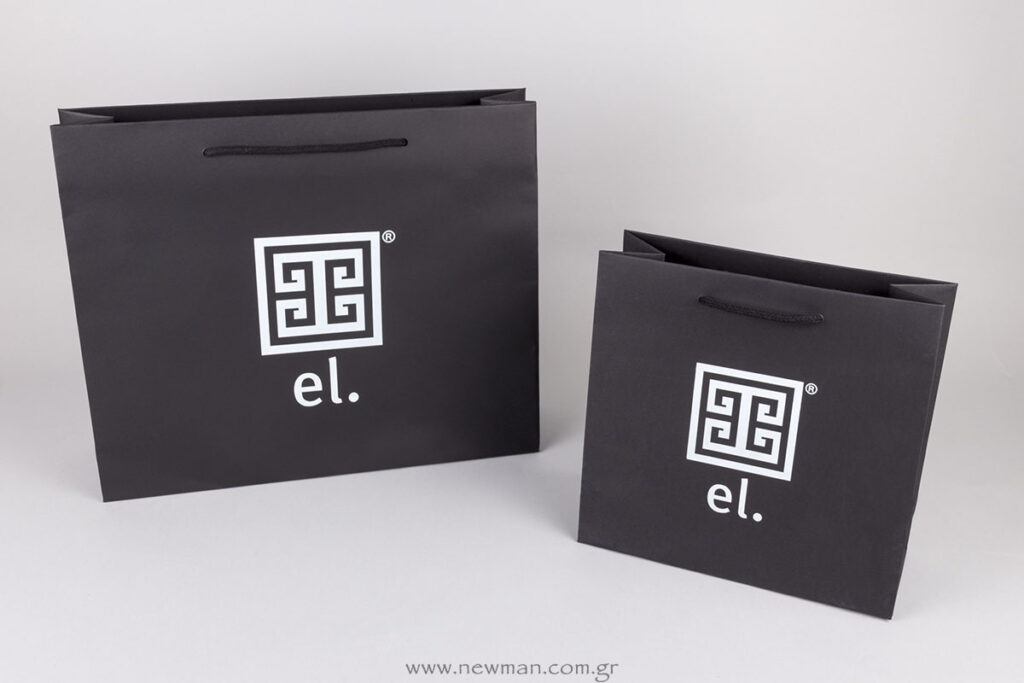 Black paper luxury bags with white logo