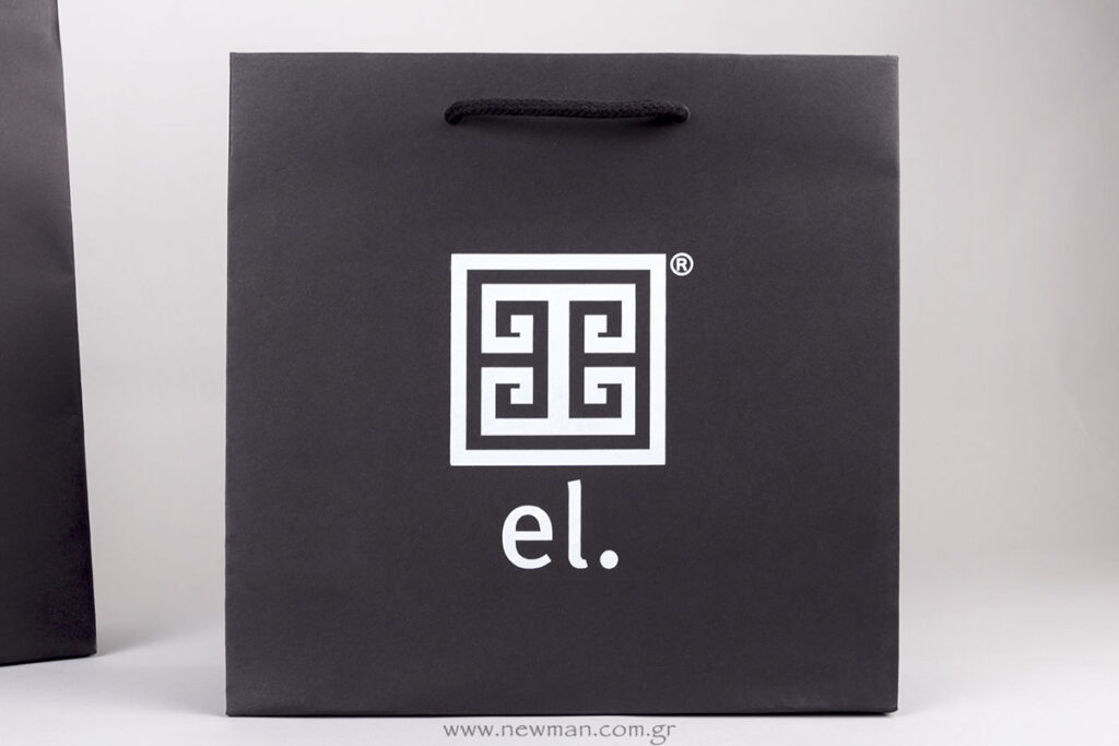 El. white logo on black paper bag