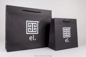 White silkscreen printing on black paper bag