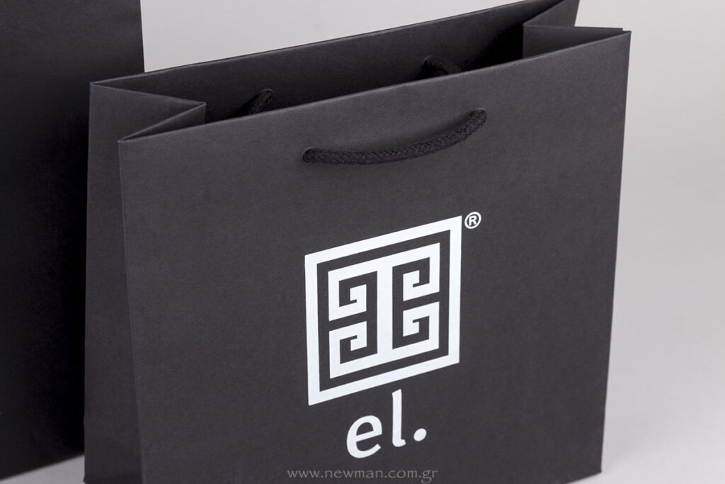 el. logo on black paper luxury bags