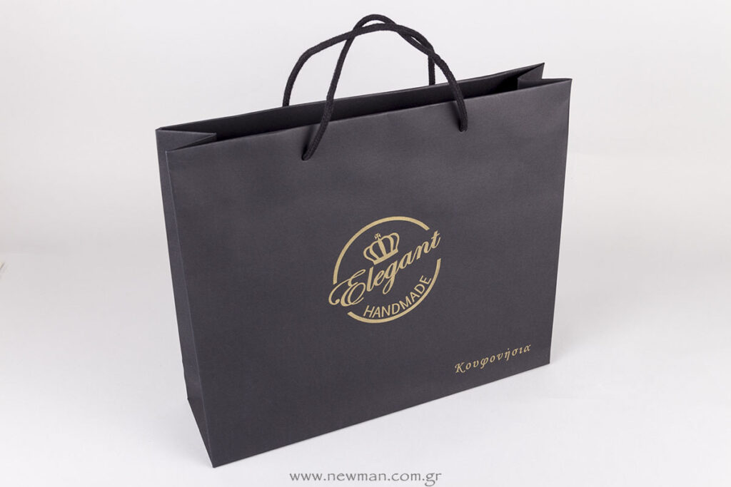 Luxury paper black bags with golden printed logo
