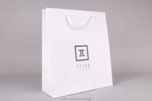 Petra logo on white paper luxury bag