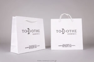 "White luxury paper bags with black logo ""Τοξότης"" jewellery"