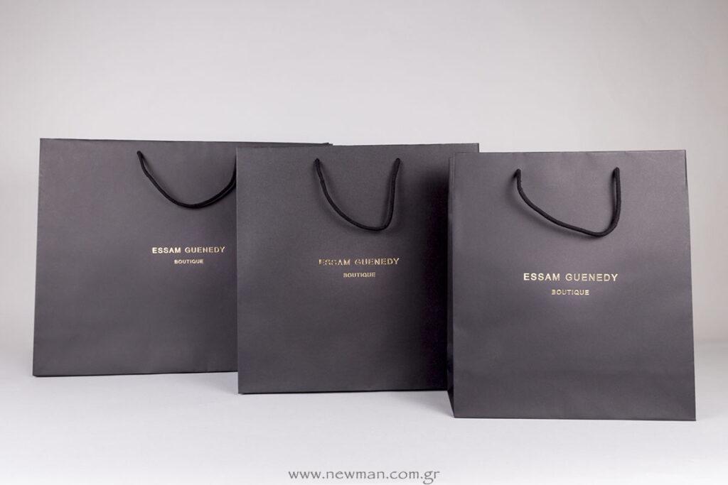 Essam Guenedy logo σε χάρτινη τσάντα πολυτελείας μαύρη Burano