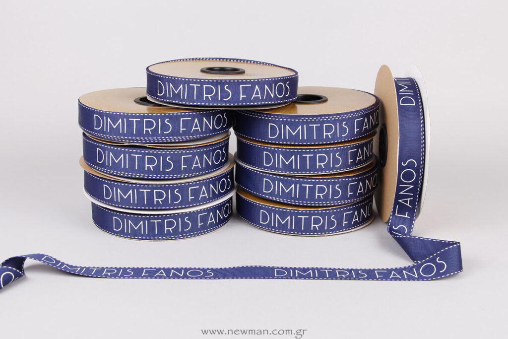 Embossed logo printing on stitched grosgrain blue ribbon
