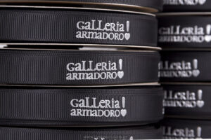 Galleria Armadoro! silver embossed silk-screen printing on black ribbons