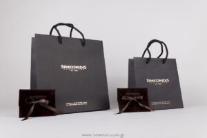 Simeonidis gold logo on bags & debossed logo on pouches