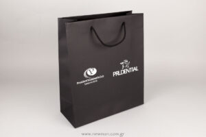 White silk-screen printing on black luxury paper bags