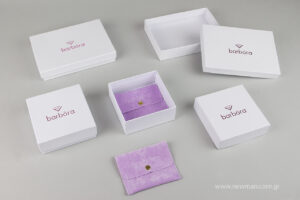 Custom-made boxes with hot foil printing technique and pouches with debossing printing technique for Barbora Jewellery.