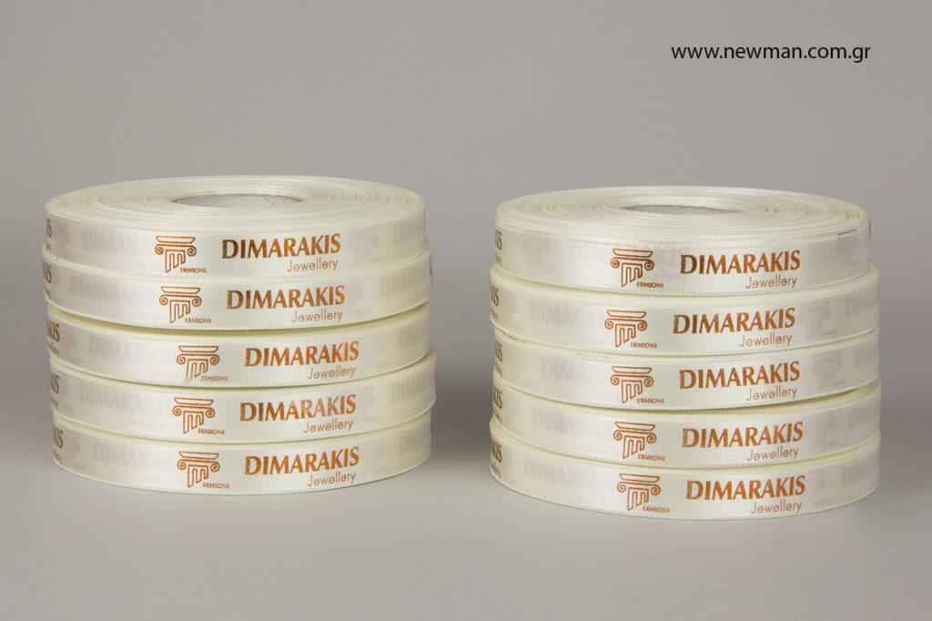 H Newman Packaging τύπωσε εκρού σατέν κορδέλες με εκτύπωση του λογότυπου με μεταλλοτυπία / θερμοτυπία σε μπρονζέ χρώμα.