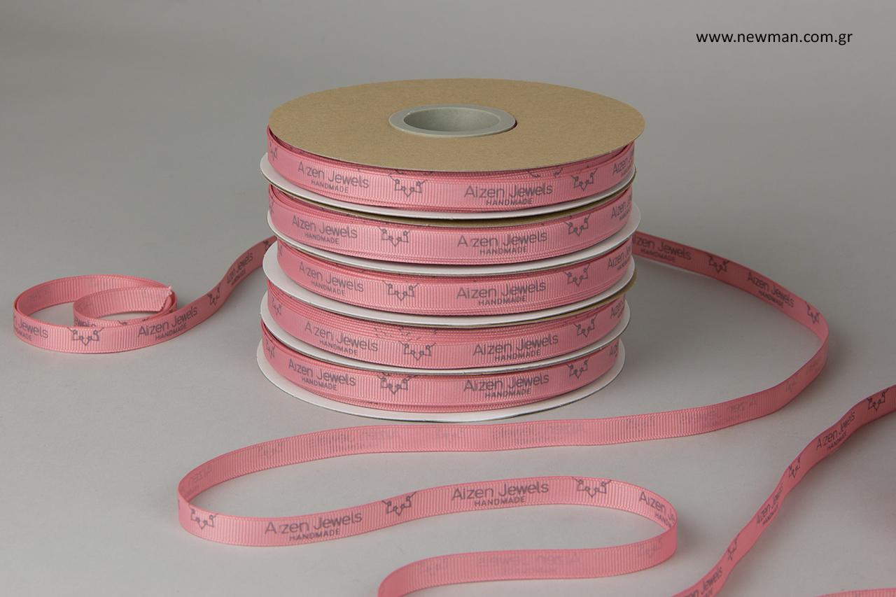 Aizen Jewels: Printed puce grosgrain ribbon with dark gray print.