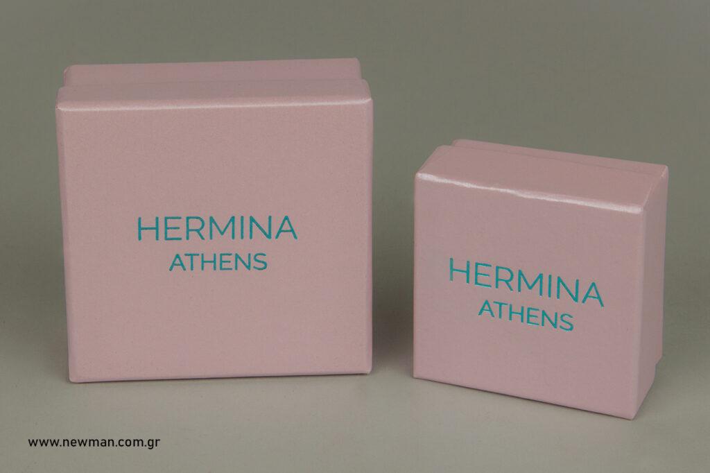 Τυπωμένα ροζ περλέ κουτιά κοσμημάτων.