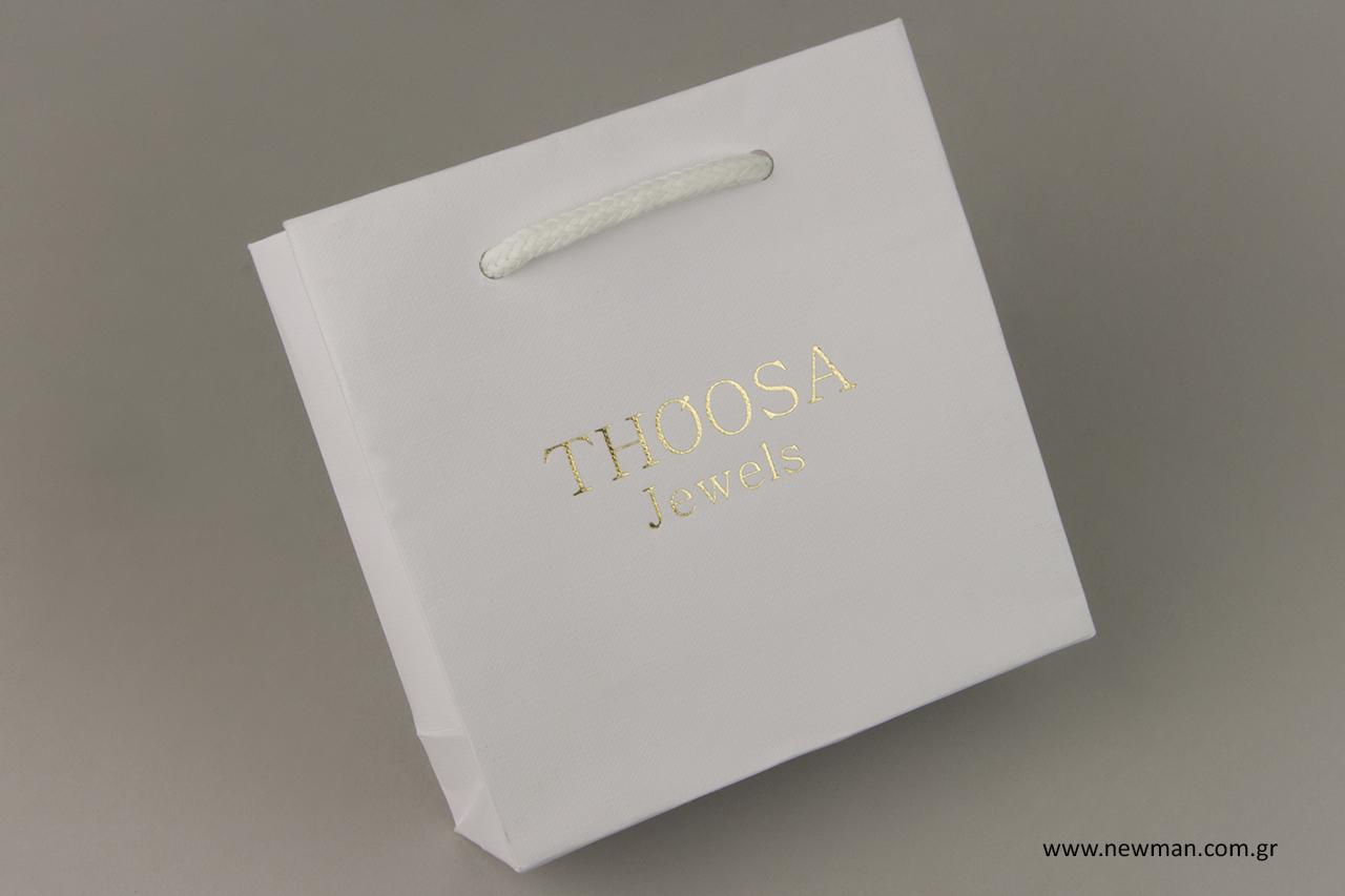 Χάρτινη τσάντα για ψώνια με χρυσή εκτύπωση.