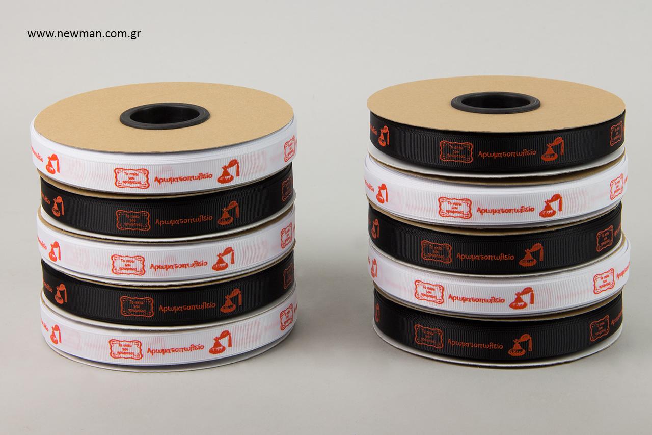Ανάγλυφη εκτύπωση εταιρικής επωνυμίας σε κορδέλες.