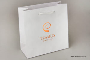 Tzamos κοσμηματοπωλείο: Τυπωμένες τσάντες NewMan με εταιρικό λογότυπο.