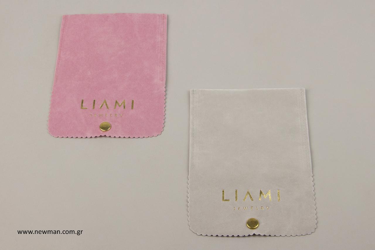 Ροζ και γκρι ανοιχτό θήκες για κοσμήματα από σουέτ υλικό με την εταιρική επωνυμία της μάρκας LIAMI.