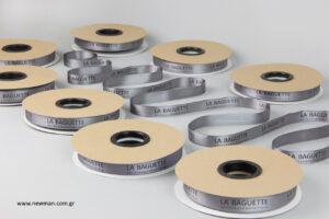 La Baguette: Είδη συσκευασίας NewMan με εκτύπωση λογότυπου.