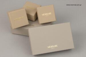 Merbabe: Χρυσή μεταλλοτυπία σε σκληρά κουτιά NewMan.