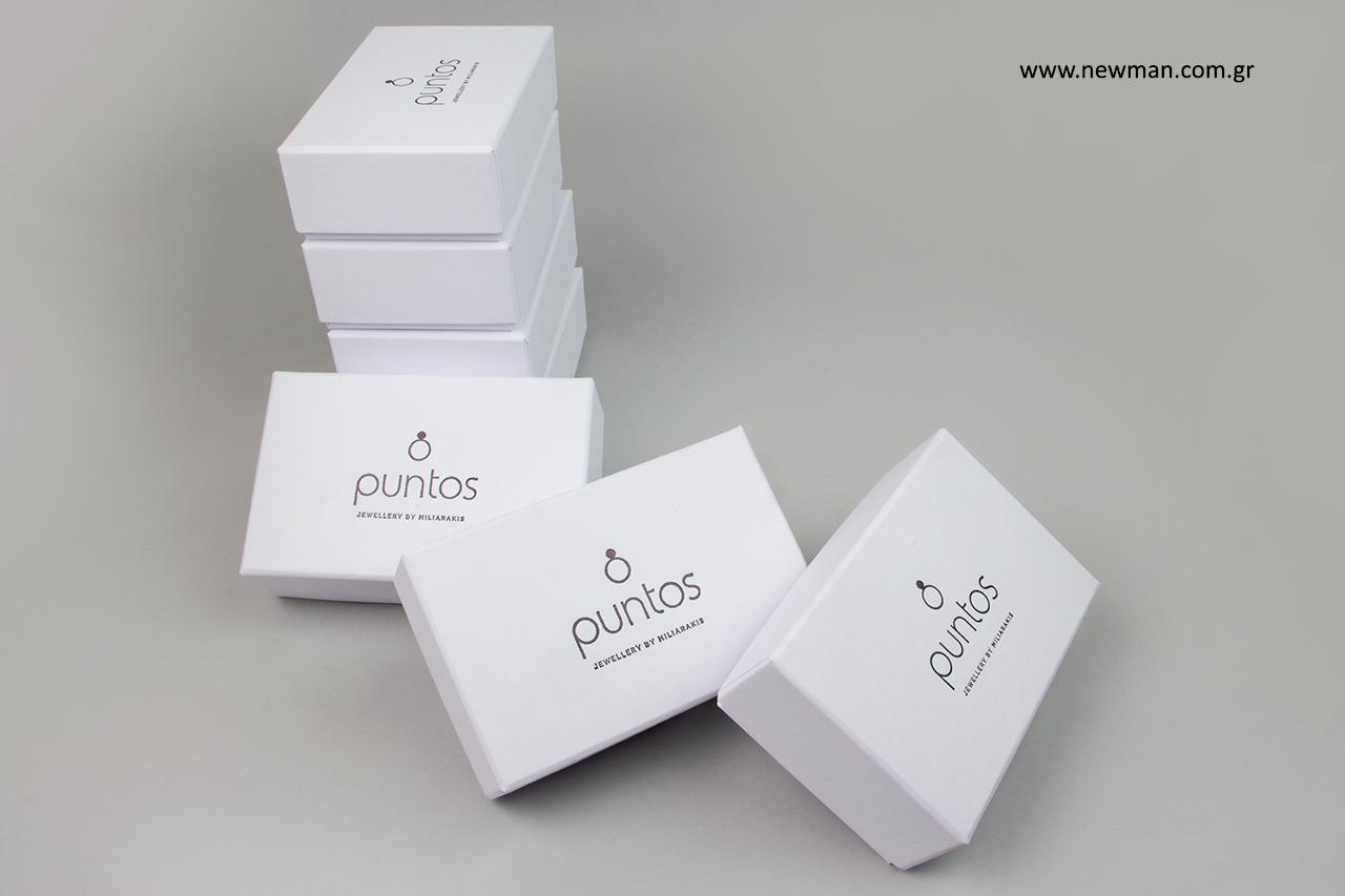 Τυπωμένα κουτιά συσκευασίας με μαύρη θερμοτυπία.