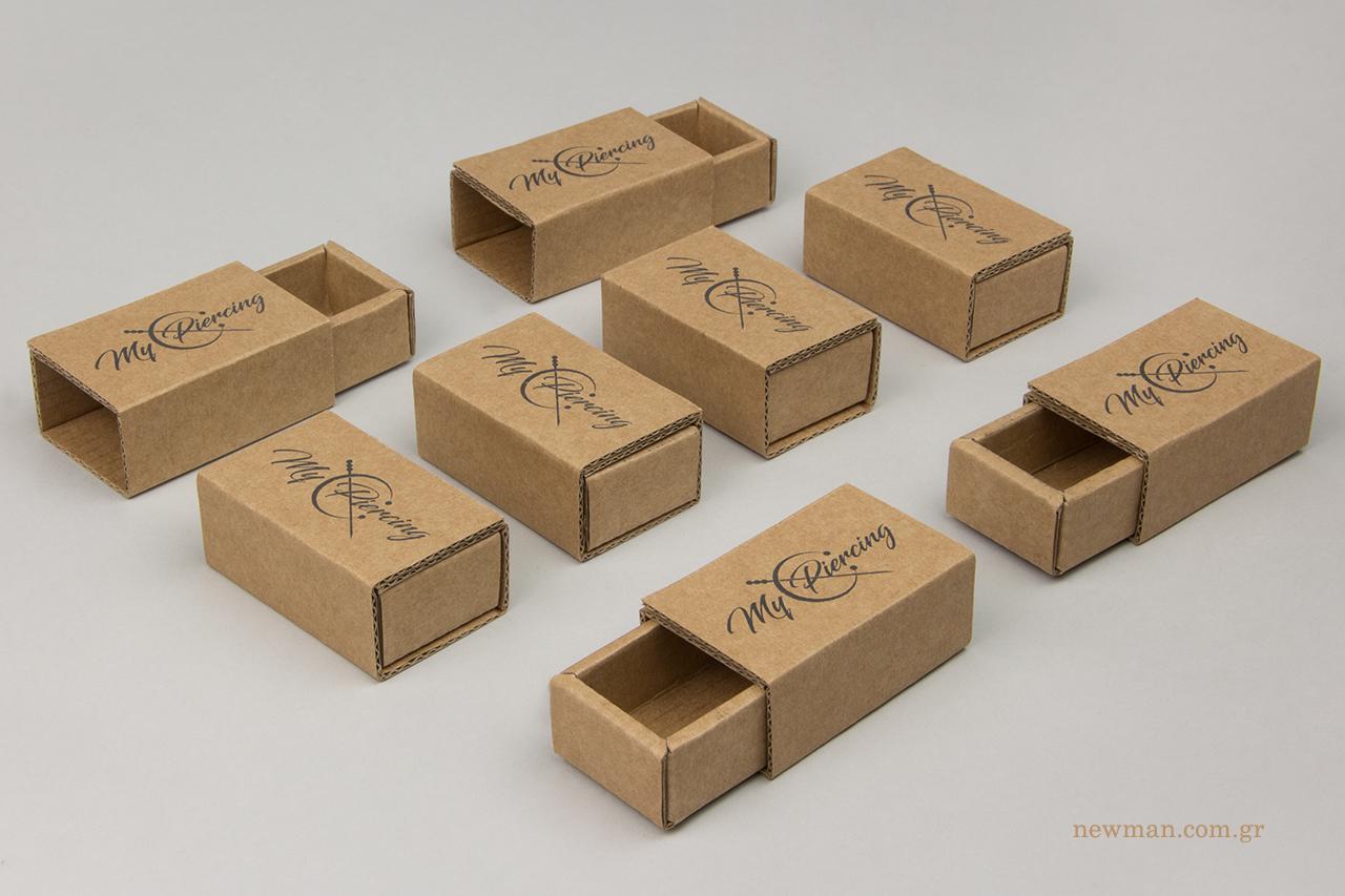 Τυπωμένα οικολογικά κουτιά τύπου σπιρτόκουτο με λογότυπο.