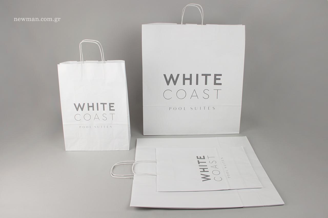 Εκτύπωση εταιρικής επωνυμίας σε λευκές οικολογικές σακούλες.